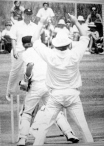 Des stumps Garth McKenzie off bowling of Jackie du Preez. Richie Kaschula and Mike Procter look on.